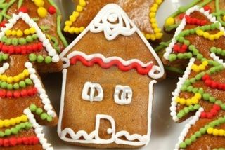 8379437-christmas-gingerbread-house-and-colorful-decorated-christmas-trees